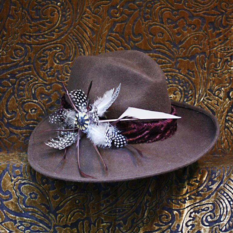A fabulous stylishly-shaped chocolate brown fur felt hat. Trimmed with striking feathers.